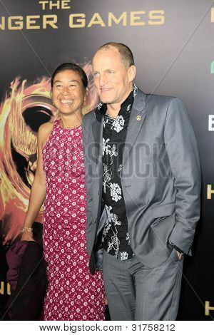 LOS ANGELES, CA - MAR 12: Woody Harrelson, Laura Louie at the premiere of Lionsgate's 'The Hunger Games' at Nokia Theater L.A. Live on March 12, 2012 in Los Angeles, California