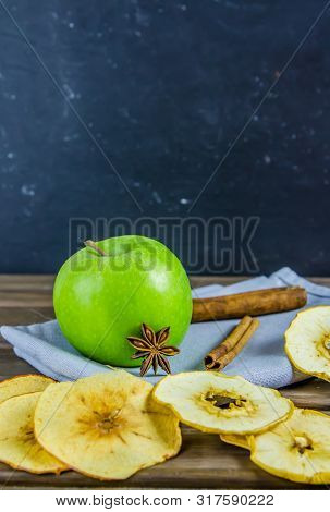 Vegetarian Apple Chips With Cinnamon And Badyan On A Brown Background