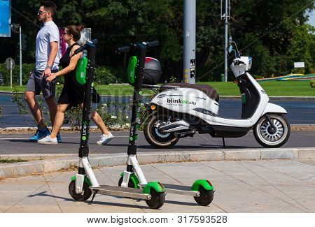 Bucharest, Romania - August 08, 2019: Two Lime-s Electric Scooters Are Parked Near A Blinkee.city El