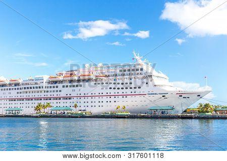 Nassau, Bahamas - September 07, 2014: Carnival Fantasy Cruise Ship Anchors At The Port Of Nassau.