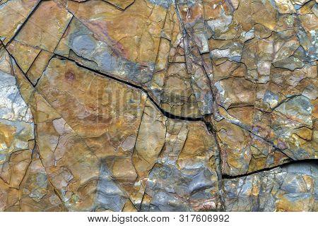 Colorful Rock Face With Cracks, Newfoundland, Canada