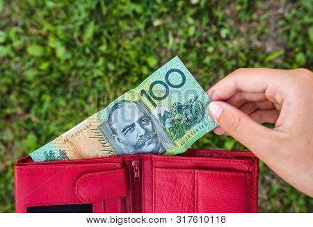 Woman Hand Holds Wallet With Australian Dollar Paper Money