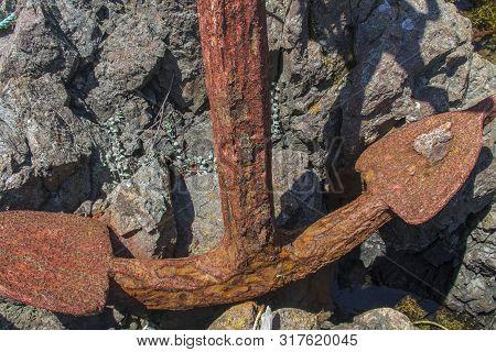Large Old Rusty Anchor On Rocks, Newfoundland