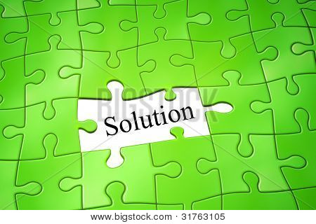 An image of a green jigsaw puzzle solution
