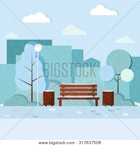 Wooden Bench, Trash Can And Streetlight In City Park With Skyscrapers, Tree And Bushes, Footpath, Cl