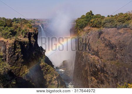 Victoria Falls And Gorge With Rainbow, Zambezi River, Between Zimbabwe And Zambia, Africa