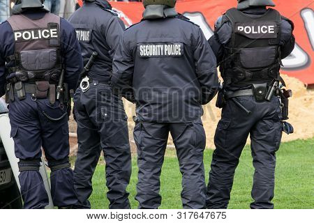 Police Officers On The Football (soccer) Field