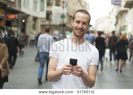Smiling Man With Cell Phone Walking