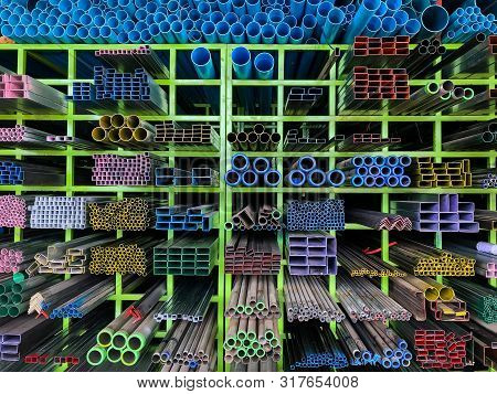 Shelves Of Different Metal Products And Pvc Tubes, Pipe Pvc  And  Different Metal Products On The Sh