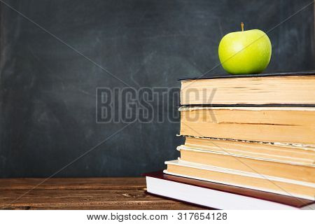 Green Apple Over Pile Of Books For Shool Concept. Education Concept, Toned And Soft Focus Image