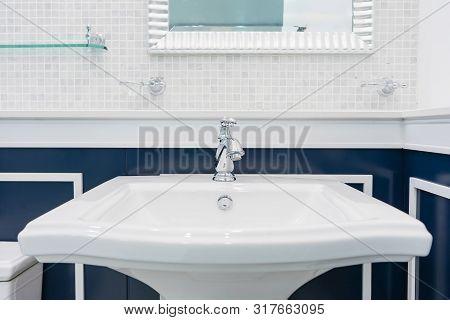 Interior Of Bathroom With Sink Basin Faucet. Chrome Faucet Washbasin. Modern Design Of Bathroom