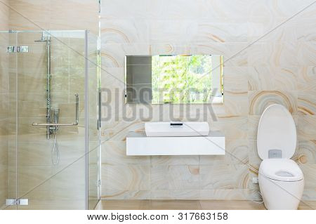 Bright New Bathroom Interior With Glass Walk In Shower With White Tile Surround, Toilet, Bidet, Basi