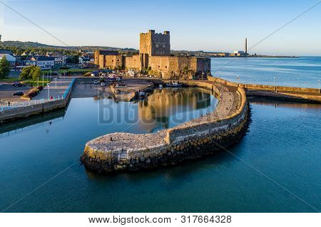 Medieval Norman Castle And Harbor In Carrickfergus Near Belfast, Northern Ireland, Uk. Aerial View