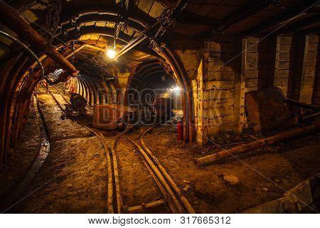 Underground Mining Tunnel With Rails. Copy Space. Work In An Underground Coal Mine