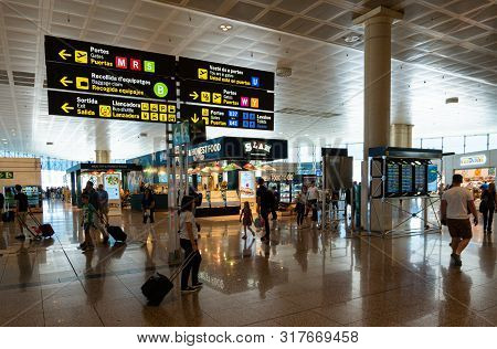 Barcelona, Spain. August 2019: Passengers In Transit In Terminal 2 Of Barcelona International Airpor