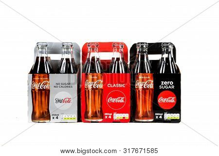 London, United Kingdom, 16th August 2019:- Packs Of Glass Bottles Of Diet Coke, Coca-cola Classic An