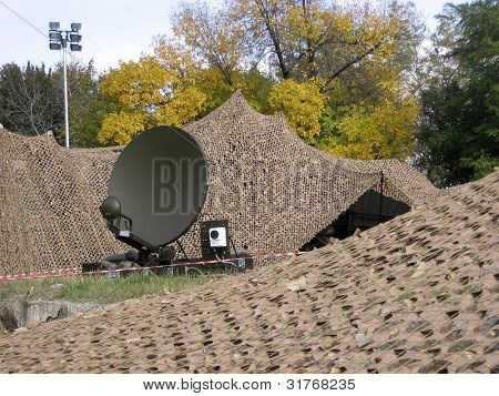 A camouflaged tactical military satellite dish