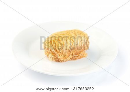 Greek Pastry Kataifi With Shredded Filo Dough Stuffed With Almond Nuts, In Honey Syrup, Isolated On