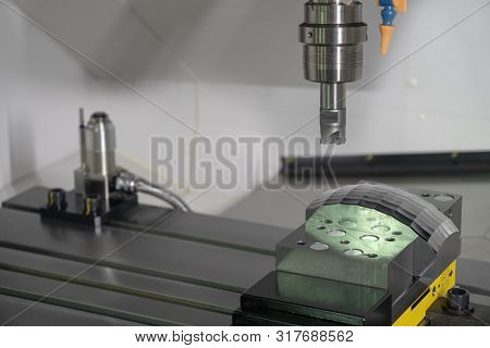 The Cnc Milling Machine Rough Cutting The Mould Parts With Indexable Tool. The Mould And Die Manufac