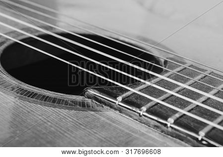 Details Of An Old Acoustic Guitar, The Sound Hole, Frets And Nylon Strings. Wooden Acoustic Guitar,