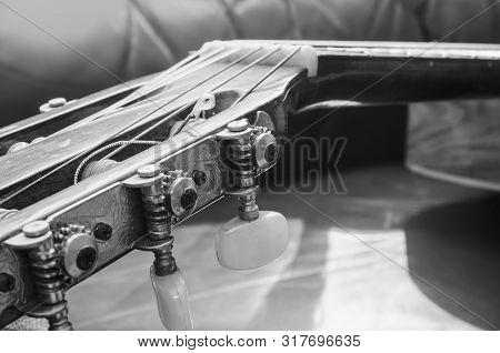 Tuning Pegs And Gears Of The Headstock Of An Acoustic Guitar. Details Of The Head Of An Old Acoustic