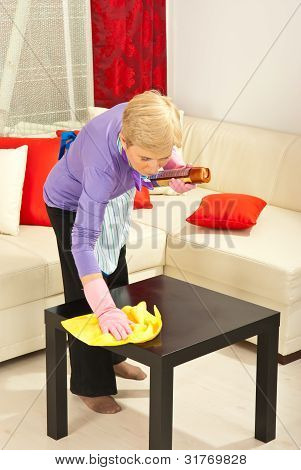 Woman Wipe Dust On The Table
