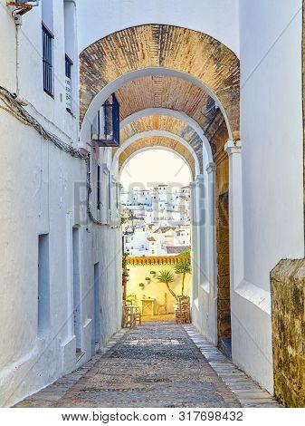 Arch Of The Nuns, Arco De Las Monjas, In The Jewish Quarter Of Vejer De La Frontera Downtown. Cadiz