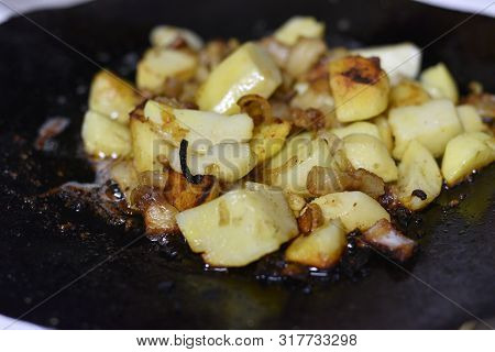 Cooking Fried Potatoes In Outdoor Conditions On Fire. Fire Fried Potatoes. Summer Food. Simple Food.