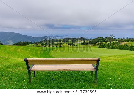 Park Bench Outdoor Landscape. Wooden Bench In Golf Course Landscape. Mountain Park Bench Panorama. P