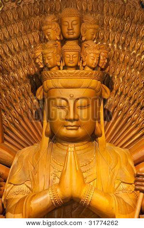 Golden Wood Statue of Guan Yin with 1000 hands poster