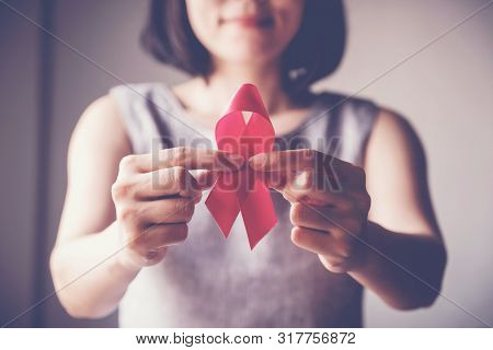 Asian Woman Holding Pink Ribbon, Breast Cancer Awareness, October Pink Concept