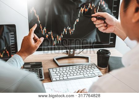 Business Team Investment Entrepreneur Trading Discussing And Analysis Finance Market Graph Stock Mar