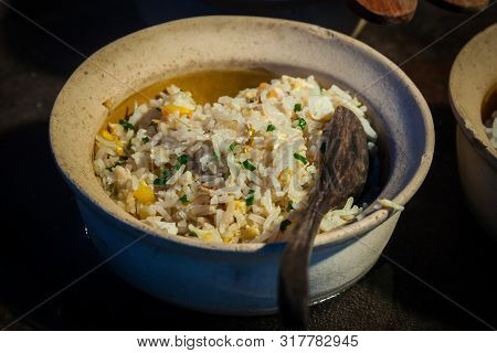 Fried Rice In Bowl With Spoon On Buffet Line ..