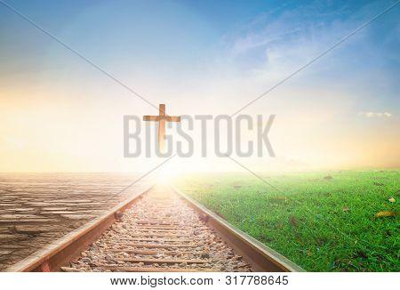 Jesus Christ Cross Concept: Crucifixion Of Jesus Christ Cross At Sunset Background