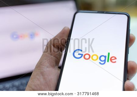 Chiang Mai, Thailand - May.26,2019: Man Holding Xiaomi Mi Mix 3 With Google Search On Screen. Google