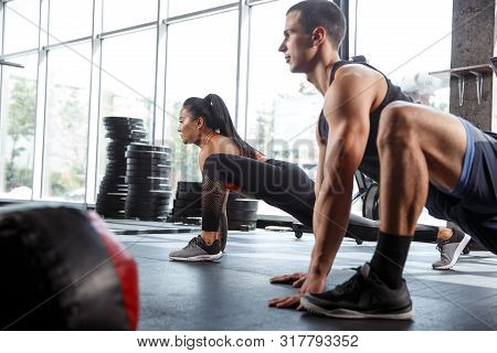 A Muscular Athletes Doing Workout At The Gym. Gymnastics, Training, Fitness Workout Flexibility. Act
