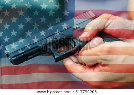 United States Gun Laws - Guns And Weapons. A Hand Of Man Practicing Firing Using A Glock Gun Model A