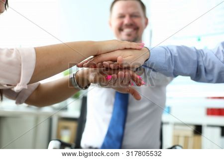 Focus On Folded Hands Of Colleagues On Each Other. Managers Underwriting Good Deal And Celebrating C