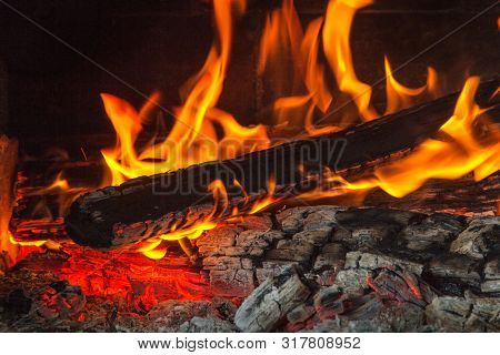 Burning Wood At Night. Flame And Fire Sparks On Dark Abstract Background. Cooking Barbecue Outdoor.