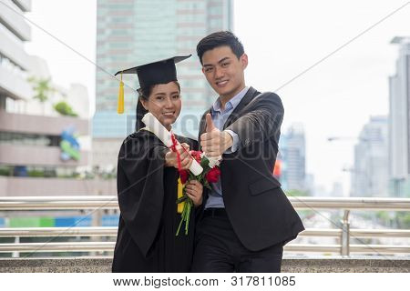 Graduate Students And Success Education In University Concept. Happy Couple Of Asian Students Gradua