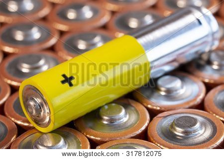 Multiple Used Aa Alkaline Batteries And A Single Aaa Battery Are Seen Arranged In A Pile. Closeup Si