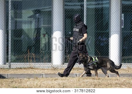 Customs And Border Protection Officer And Drug Enforcement Administration Special Force Participates
