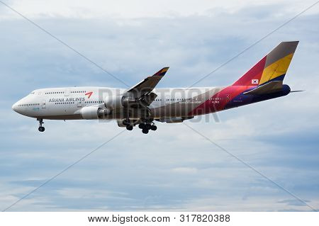 Frankfurt / Germany - August 18, 2013: Asiana Airlines Boeing 747-400 Hl7421 Passenger Plane Landing