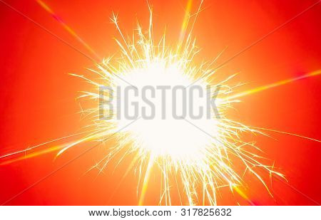 Close-up Bengal Light Explosion With Sparckles On Red Background. Flamy Template With Copy Space