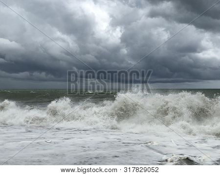 Storm At Sea, Storm Warning On The Coast. Thunderclouds And Big Sea Waves During A Storm. Restless S