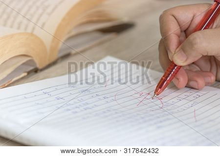 Concept Of Measurement And Evaluation. Hand Of Teacher Using Red Pen Written Grade A And Circle On M
