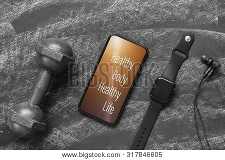 Fitness Healthy Lifestyle Mockup Smartphone Concept. Healthy Body Healthy Life Quote On Mobile Phone