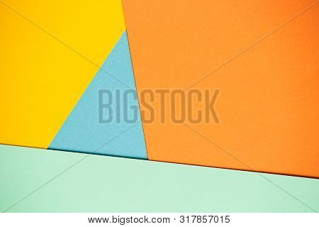 Photo Of Colored Sheets Of Paper: Yellow, Orange, Blue And Green. Suitable For Design Templates, Cov