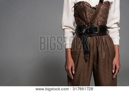 Partial View Of Steampunk Woman In White Blouse On Grey