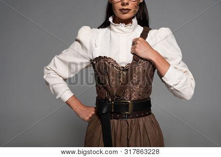 Cropped View Of Steampunk Woman With Makeup Standing With Hand On Hip Isolated On Grey
